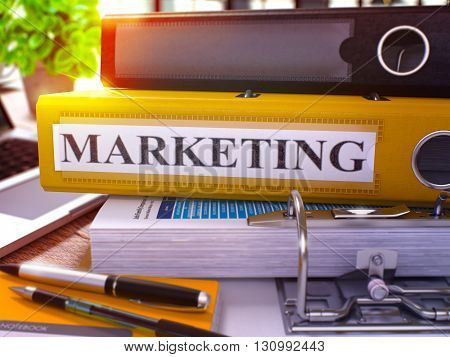 Marketing - Yellow Office Folder on Background of Working Table with Stationery and Laptop. Marketing Business Concept on Blurred Background. Marketing Toned Image. 3D.