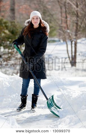 Smiling Woman Shoveling Snow