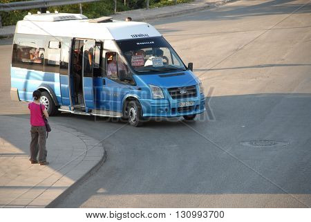 ANKARA/TURKEY-AUGUST 31, 2008: Blue minibus at the road for public transportation.August 31, 2008-Ankara/Turkey
