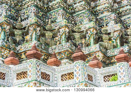 Detail of the temple of Wat Arun with statues of demon guardians. Bangkok, Thailand
