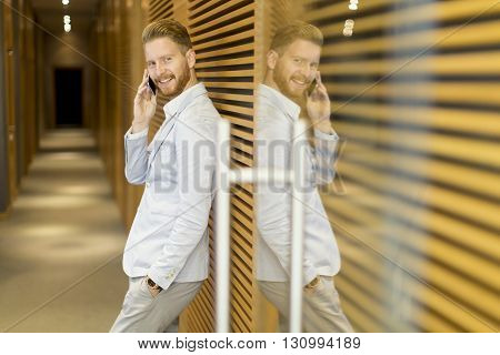 Redhair Businessman On The Phone In The Office