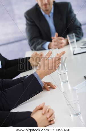 Closeup of hands on business meeting at office, businessman explaining to others.