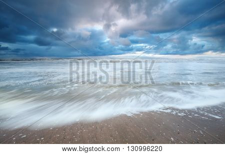 North sea coast and rainy sky North Holland Netherlands