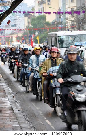 Traffic In Hanoi. Crowd Of Motorbike Drivers On The Street