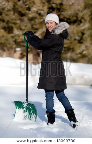 Cute Woman Shoveling Snow