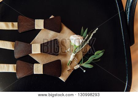 Wooden Bow Ties On A Ivory Table