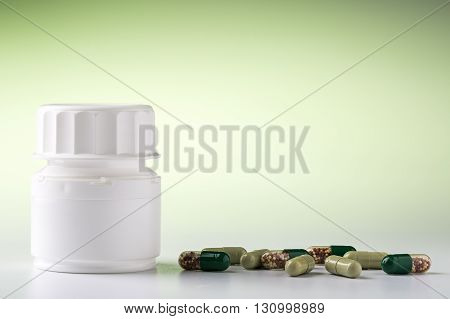 Medicine bottle and various colorful medical pills and drugs for pharmacological treatment