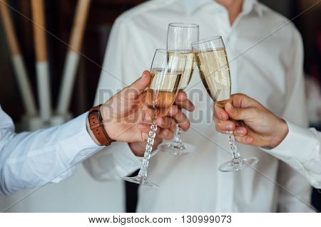 Three Successful Businessman Toasting Champagne