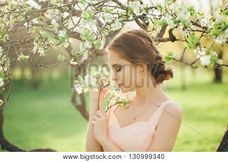 spring , summer beauty portrait of brunette girl in pink dress