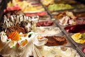 foto of gelato  - colourful gelato flavors in display case in summer - JPG