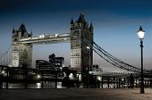 The famous landmark of London: the Tower Bridge and the Themes by night. poster