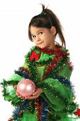 Little smiling girl in green Christmas tree costume