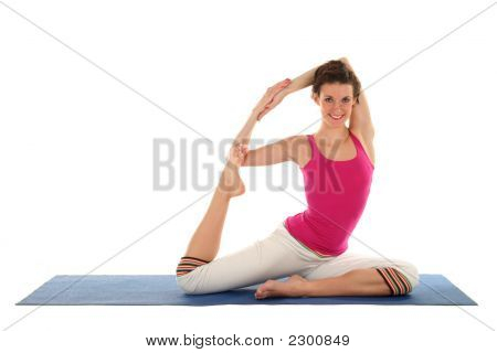 Young Woman In Pigeon Pose