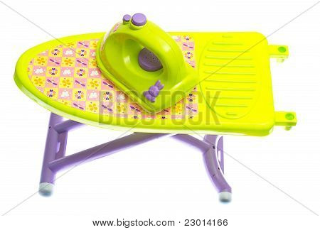 Toy Iron And Ironing Board On White