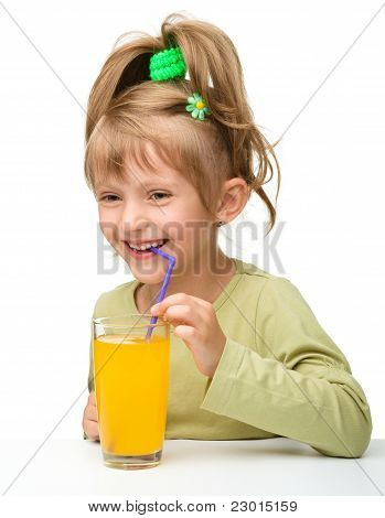 Cute Little Girl Is Drinking Orange Juice