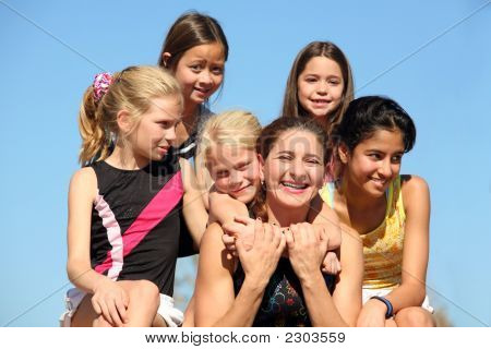 Woman And Five Girls