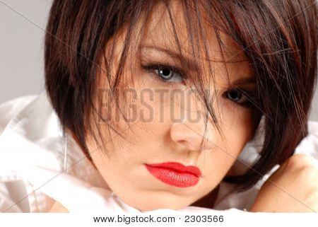 Beautiful Dark Haired Woman In A Sultry Pose