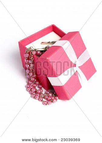 Pink gift box with a white bow, and pink rosary