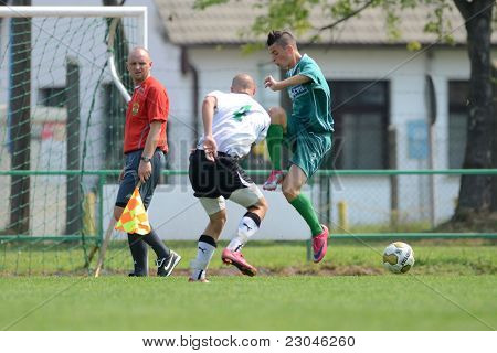 KAPOSVAR, HUNGARY - AUGUST 27: Konrad Kiss (R) in action at the Hungarian National Championship under 18 game between Kaposvar (green) and Gyor (white) August 27, 2011 in Kaposvar, Hungary.