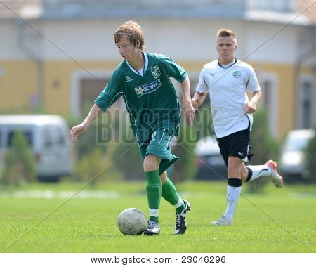 KAPOSVAR, HUNGARY - AUGUST 27: Krisztian Nagy (L) in action at the Hungarian National Championship under 18 game between Kaposvar (green) and Gyor (white) August 27, 2011 in Kaposvar, Hungary.