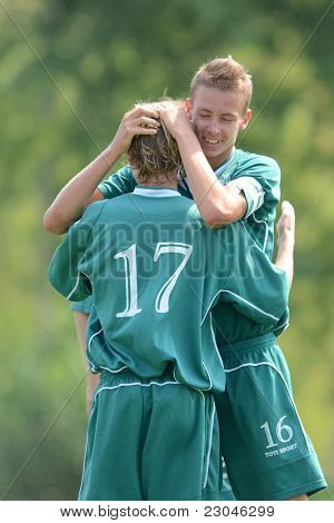 KAPOSVAR, HUNGARY - AUGUST 27: Kaposvar players celebrate at the Hungarian National Championship under 18 game between Kaposvar (green) and Gyor (white) August 27, 2011 in Kaposvar, Hungary.