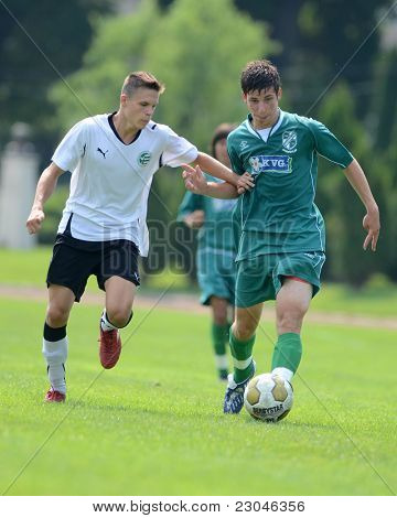KAPOSVAR, HUNGARY - AUGUST 27: Gergely Sandor (in green) in action at the Hungarian National Championship under 18 game between Kaposvar (green) and Gyor (white) August 27, 2011 in Kaposvar, Hungary.
