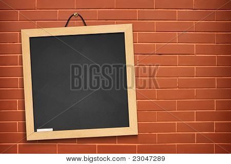 Blackboard on brown wall background