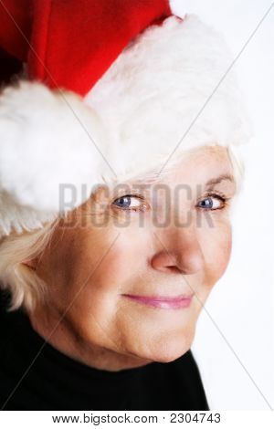 Senior Lady With Santa Hat