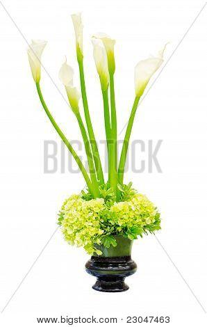 Wedding flower arrangement centerpiece with calla lily and green hydrangea in an urn