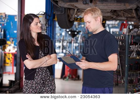 An angry customer talking to a mechanic in an auto repair shop