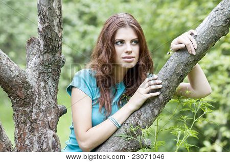 Beautiful girl and tree