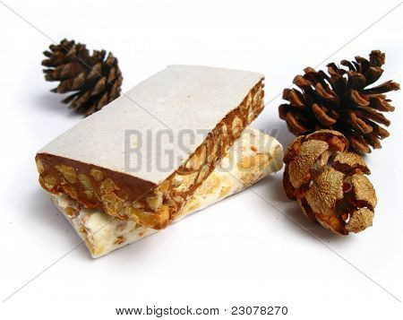 Nougat with pine cones on a white background