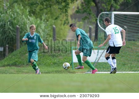 KAPOSVAR, HUNGARY - AUGUST 27: Konrad Kiss (green 4) in action at the Hungarian National Championship under 18 game between Kaposvar (green) and Gyor (white) August 27, 2011 in Kaposvar, Hungary.