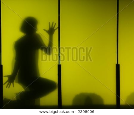 Boy'S Shadow On Yellow Panel