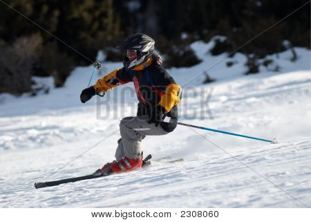 Fast Mountain Skier Downhill On Ski Resort Slope