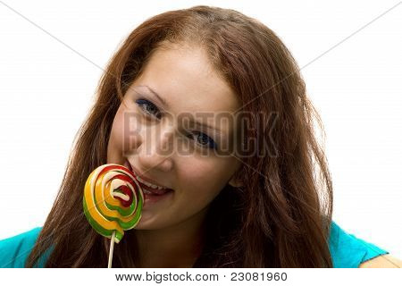 Lovely Young Woman With Lolipop