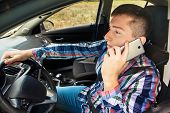 Casual Businessman Talking On Cellphone While Driving A Car, Side View. Handsome Young Man In Plaid  poster