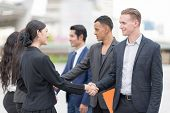 Business Partners Shaking Hand After Complete A Deal. Confident And Active Businesspersons Creative  poster