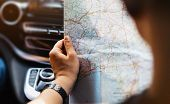 Hipster Man Holding In Male Hands And Looking On Navigation Map In Auto, Tourist Traveler Hiker Driv poster