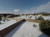 Plot Of Land In Winter. Construction Of A Private House. Fence On The Land In Winter. poster