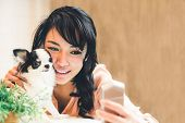 Beautiful Asian Woman Taking Selfie With Cute Chihuahua Dog At Home, With Copy Space. Lovely Human A poster