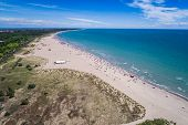 Italy, the beach of the Adriatic sea. Rest on the sea near Venice. Aerial FPV drone photography. poster