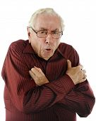 image of shivering  - Portrait of a shivering senior man on a white background - JPG