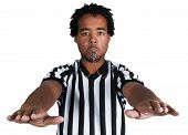 picture of umpire  - young male African American referee gesturing a generic play sign - JPG