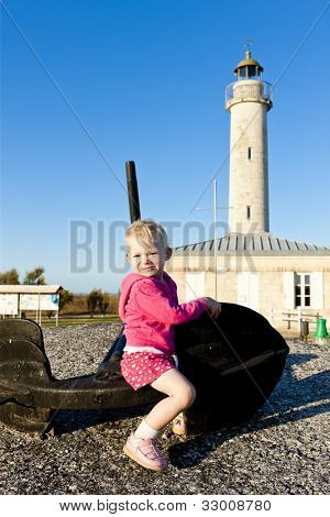 sitting little girl, Richard Lighthouse, Aquitaine, France