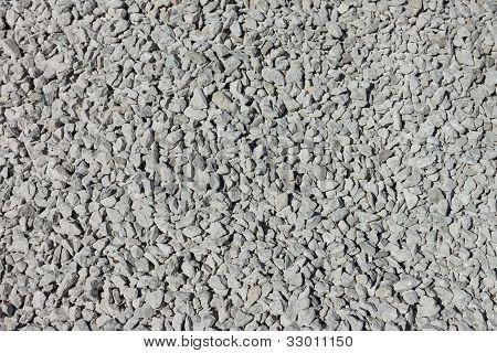 Muchas pequeñas piedras grisáceas