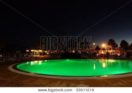 Green pool at night