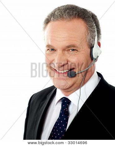 Smiling Senior Male Operator. Closeup Shot