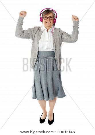 Cheerful Aged Woman Enjoying Music