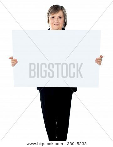 Female Executive Standing With A Blank Billboard